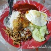 The sambal and rice defines a plate of nasi lemak